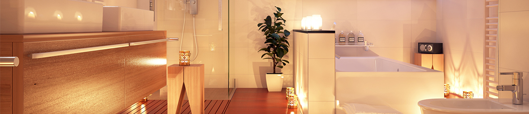 modern bathroom lit by candles