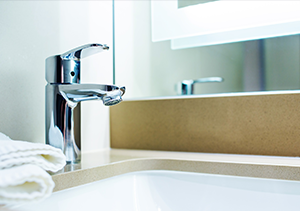 modern style tap by sink