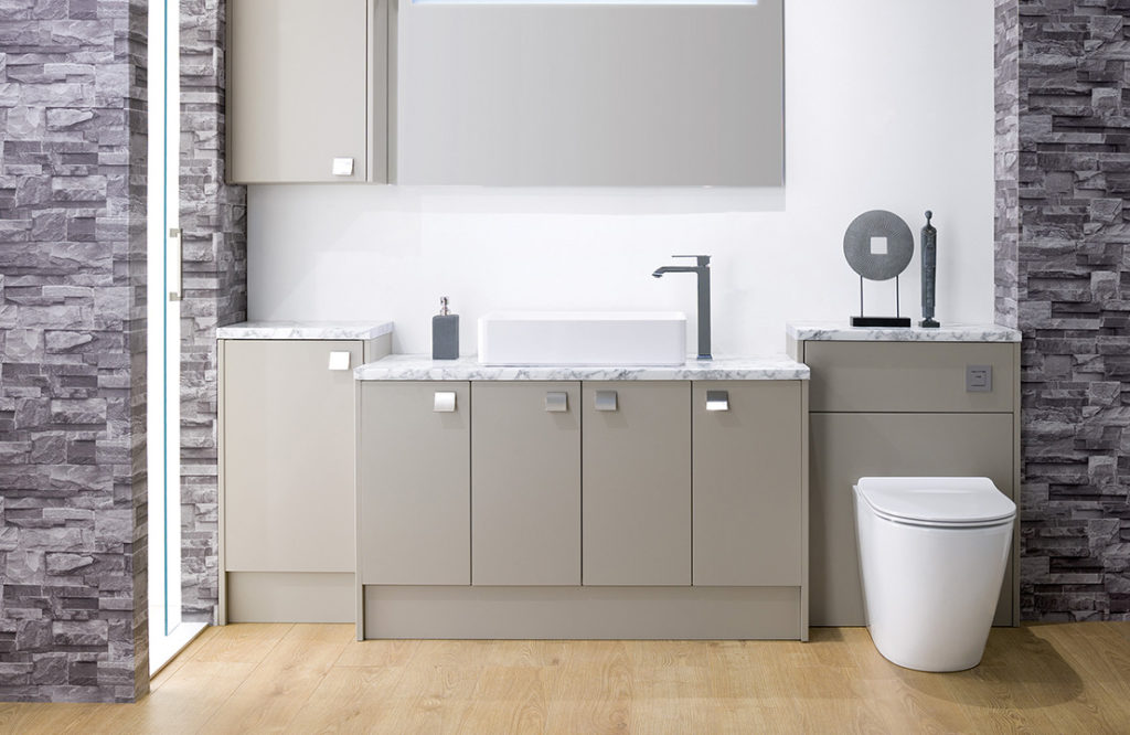 modern bathroom suite showing sink and toilet